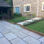 Large steps and landing areas to ease you into the main part of the garden. Led lights sunken into sleepers